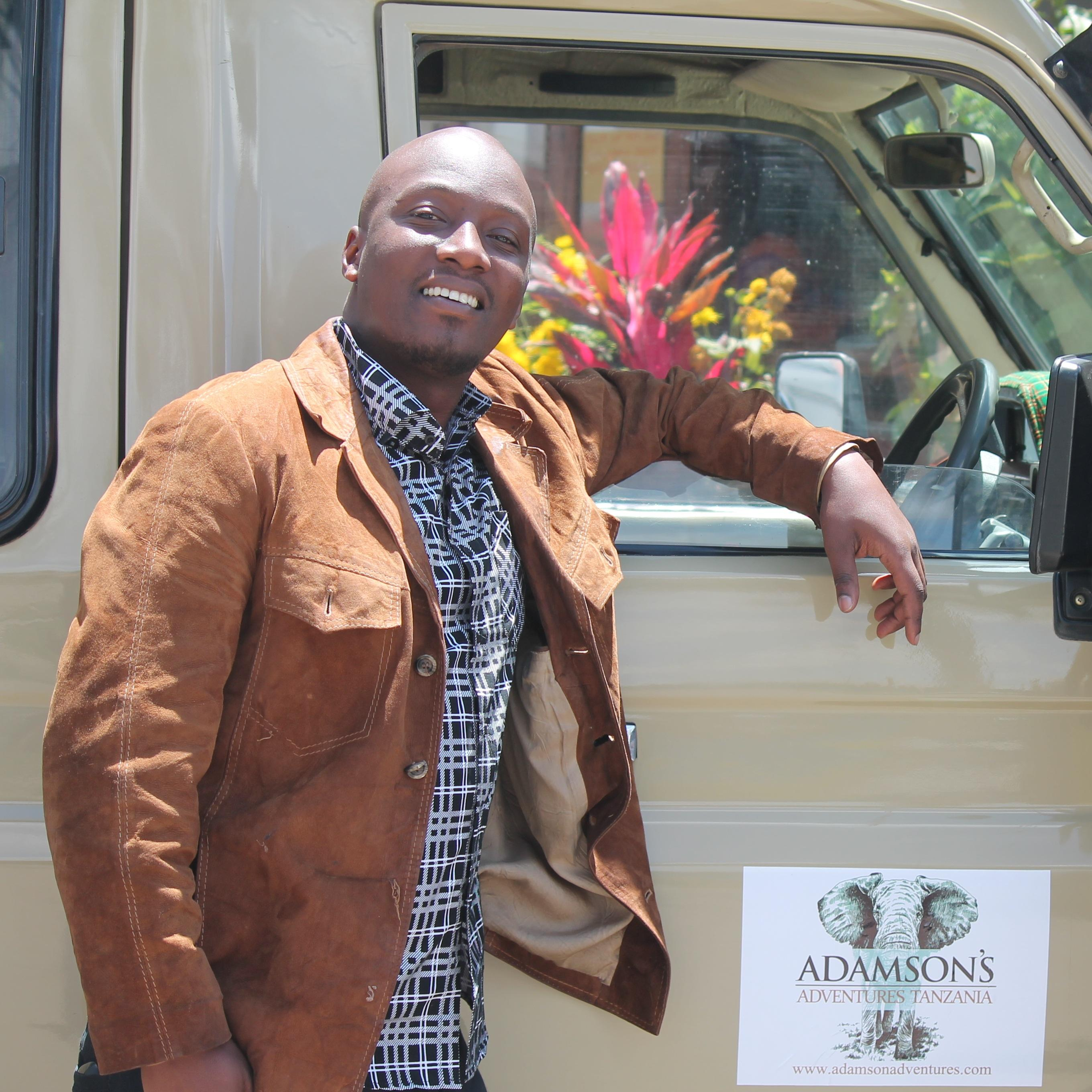 Adams Audax is a tour guide for Arusha (Tanzania)